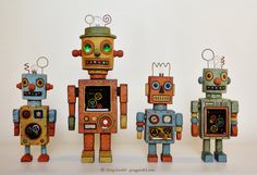 Vintage toy robot sculptures by Greg Guedel. Inspired by old tin toys. Hand carved wood, found objects and clear poured resin.   www.gregguedel.com
