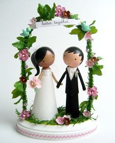 Whimsical cake toppers by Lollipop Workshop can be personalized to represent the bride and groom.Shop Them on Etsy
