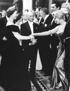Marilyn Monroe meets Queen Elizabeth II, London, 1956 | curtsey | The Queen | tiara | hollywood starlet | black & white photography | moment captured | gowns and gloves | suit and tie | formal attire | iconic women | strong influential women of yesteryear | www.republicofyou.com.au