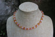 "Baltic Amber Beads between 5mm Pink Peruvian Opal Stone Beads. Hand Knotted Necklace on Cotton String with a Plastic Screw Clasp 12"" Long designed for an infant or toddler. We are also happy to do cus"