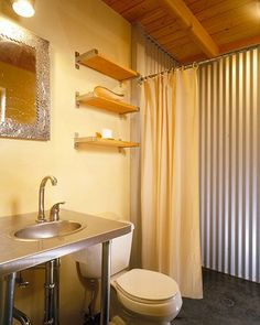 This 750 square feet cabin was made from SIP panels built off-site for easier construction in Mazama, Washington. Diy Bathroom Vanity, Tiny House Bathroom, Basement Bathroom, Bathroom Ideas, Budget Bathroom, Small Bathrooms, Bathroom Wall, Basement Remodel Diy, Basement Remodeling