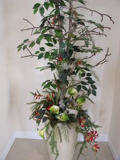I created this ficus design to fit in client's entry niche.  It needed to be faux, yet have some color.  Decided to add a container with some flowers spilling out.  Also some clusters in the unit.  One idea can spark many more...