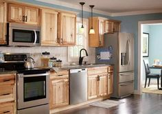 Kitchen, Astonishing Hampton Bay Natural Hickory Cabinets With Encapsulated Panels And Wall Cabinet In Natural Hickory Also Hampton Wall Kitchen Cabinet With Island Range Hoods And Ball Bearing Drawer Glides: Wonderful Menards Kitchen Cabinets For Wood Choices