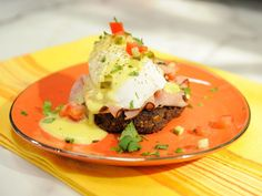 Sunny's Black Bean and Ham Eggs Benedict : Consider this impressive eggs benny a next-level version of the classic recipe. Instead of using a traditional English muffin, Sunny builds her breakfast atop protein-packed bean patties: first a layer of sliced ham, then an egg and finally a creamy lime-laced sauce.