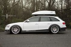Audi A4 Allroad with a roof box.