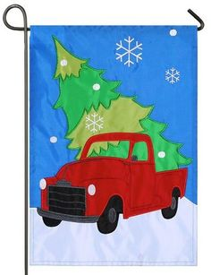 This bright red, antique truck, applique garden flag features a big, fresh cut Christmas tree being brought home for the big Holiday Family celebration. The large, white snowflakes stand out beautiful