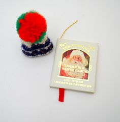Set of 2 1980s Christmas Ornaments, Yes Virginia There is a Santa Claus Mini Book Ornament, Kurt Adler, Knitted Winter Hat by UpswingVintage on Etsy
