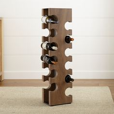 Shop Big Sur Smoke 12-Bottle Standing Wine Rack.  A sculptural tower of beautiful European oak, our show-stopping, solid wood standing wine rack holds a dozen bottles in artfully shaped notches.