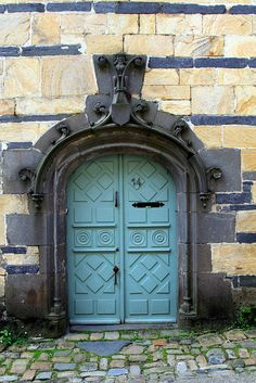 blue doors are awesome. the stones in front and the archway add to this.