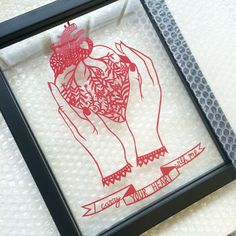 Anatomical heart papercut with a quote by E.E Cummings. Hand cut by Poppy Chancellor