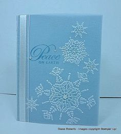 "SU Greetings of the Season, Northern Flurry E F, Vellum Card Stock   ""After embossing I used a sponge dauber to apply a small touch of Marina Mist ink to the center of the snowflakes on the back of the embossed vellum. The card stock under the vellum is Marina Mist.""  (Dec 10, 2013)  Next, the sentiment, from ,  is stamped with Maria Mist ink and then Heat Embossed with clear embossing powder."