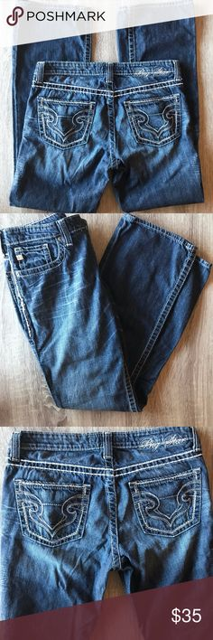 """Big Star 29x31 Maddie Boot Mid Rise Jeans Add a bit of country to your jeans with Big Star Maddie Boot mid rise bootcut jeans.  These boot cut jeans have a medium to dark wash, white trim, and touches of whiskering for a worn-in look.  Great used condition except for some very minor pilling, and some pulling of threading along side.    - Size 29R - Approx. 15.5"""" across waist - Approx. 31"""" inseam - Approx. 9"""" front rise - Approx. 8.5"""" leg opening - 99% cotton, 1% spandex Big Star Jeans Boot…"""