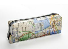 """#Recycled Misprinted Subway Map Case, $25. 8.25"""" W x 3.25"""" H x 2"""" Deep    Cleverly recycled from misprinted and outdated NYC transit maps, this #eco-friendly zippered case is perfect for carrying toiletries, cosmetics, pens or other small items whether you are going to the gym or out of town. Each #eco case is covered in plastic factory remnants for easy cleaning and durability.  Artist: Claudia Garzesi is a designer for the Recycled Planet Store."""