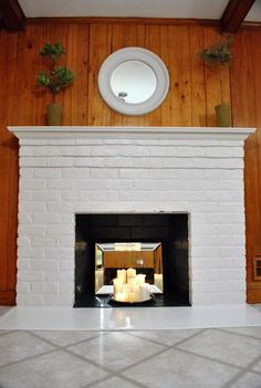 White fireplace with candles