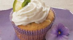 Rum syrup provides a wonderful addition to these delicious mojito cupcakes that are made using Betty Crocker® SuperMoist® cake mix - a perfect party dessert.