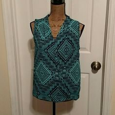 FUNKY HIGH LOW TOP Blue and teal patterned top. Cris cross style front, longer in the back. NWOT, sold as is. Pink Rose Tops Blouses