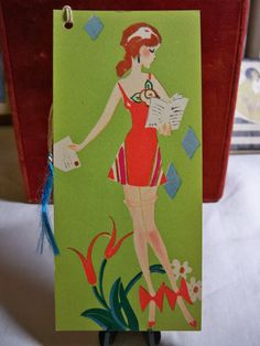 Art deco Bridge Tally  Girl in deco dress with thigh high hosiery bows at ankles Cincinnati Art publishing company.