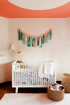 earthy coral nursery with white crib...