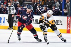 Blue Jackets vs. Penguins - 02/17/2017 - Pittsburgh Penguins - Photos  Boone Jenner #38 of the Columbus Blue Jackets skates the puck away from Trevor Daley #6