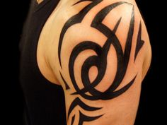 Tribal Tattoos for Men and Their Meanings Tribal Wolf Tattoo, Tribal Shoulder Tattoos, Tribal Tattoos For Men, Mens Shoulder Tattoo, Arm Tattoos For Guys, Trendy Tattoos, Cool Tattoos, Tatoos, Shoulder Tats