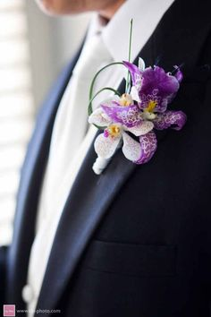 Exotic Purple and White Orchid Boutonniere, created by Passion Roots, Hawaii Wedding Florist.  www.passionroots.com
