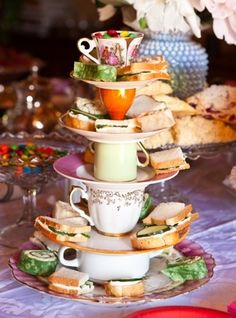 stacked tea cups with tea party food for Mad Hatter Tea Party or Tea Party Bridal Shower