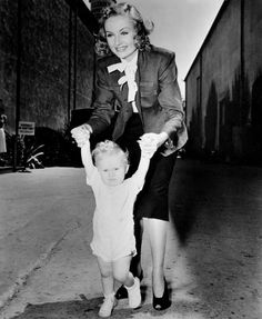 "Carole Lombard with her screen baby on the set of ""Made for Each Other"""
