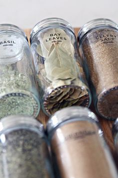 IHeart Organizing: DIY Spice Jar Labels Smart idea to add expiration date to refilled spice jars with a dry erase marker.