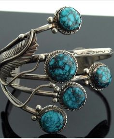 Silver bracelet with feathers and beautiful tutquoise.