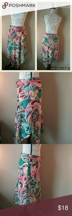 Dillards like new hippie skirt w/ leather belt Adorable skirt for spring and summer. Perfect condition. The original cloth rope belt is missing. So you get a matching pink leather Italian-made belt at no charge. It is actually worth more than the skirt! Value about $50. Total length is 36 inches.  Skirt has an approx 30 inch elastic waist and it is 22 inches tall at the shortest point. Knee length at a minimum. Value $45.  100 percent polyester--both the shell and the stretchy beige lining…