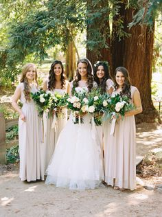 Photography: Mariel Hannah - marielhannahphoto.com Bridesmaids' Dresses: Blush Fashion - www.etsy.com/listing/237271197/ivory-wrap-dress-with-lace-sleeves?ref=shop_home_active_16 Wedding Dress: Enzoani  - enzoani.com   Read More on SMP: http://www.stylemepretty.com/2016/03/14/organic-style-wedding-in-sacramento/