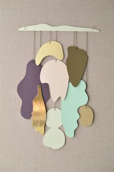 etsyfindoftheday 2 | 9.2.14 'shape shifter / gold' by karenkimmelstudios  i'm oddly drawn to this serene mobile/wall hanging from karenkimmelstudios … maybe it's the smooth organic shapes, or the dreamy hues, or the pop of gold.