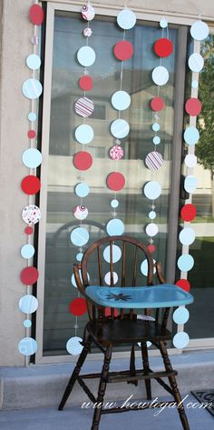 Hanging Red & Aqua Circle Decor- would be super pretty on front of the windows.