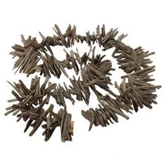 """The perfect accent for your living room or entryway decor, this eye-catching garland is crafted of driftwood and showcases a neutral grey hue.  Product: DecorConstruction Material: Natural driftwoodColor: GrayFeatures: Natural accentsDimensions: 96"""" W"""