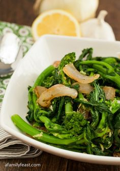 Broccoli Rabe recipe - http://www.afamilyfeast.com - The best recipe for preparing Broccoli Rabe - lemon, garlic, onion and red pepper flakes are a perfect complement to this healthy green vegetable! Plus we also share the trick to removing the bitterness from this delicious green!