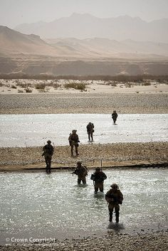 Royal Marines and soldiers from 42 Commando cross a river on a patrol during Operation Aabi Toorah in Helmand, Afghanistan.