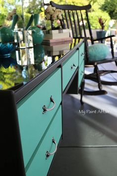 QUEEN ANNE DRESSING TABLE Beautifully painted with Annie Sloan Chalk Paint. The body is painted Graphite (dark grey). Drawers are my Tiffany Blue (aqua). The trim around drawers are painted Paris Grey. Dark smoked glass on table top.