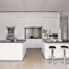 Modern Minimalism: The kitchen in this New Jersey home, renovated by architect Annabelle Selldorf with handsome modern decor by designer Matthew Frederick, features a Gaggenau cooktop and wall ovens and Dornbracht sink fittings. Classy. What do you think? ➖ #kitchen #kitchentools #kitchenisland #kitchens #kitchenlife #happywife #kitchenrenovation #kitcheninspiration #kitchenmakeover #kitchenideas #kitchengoals #kitchenstyle #kitchentips #kitchenlover #kitchenqueen #mykitchen #TheArtOfPlating…