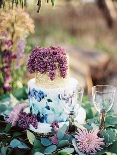 Floral cake topped with lilacs