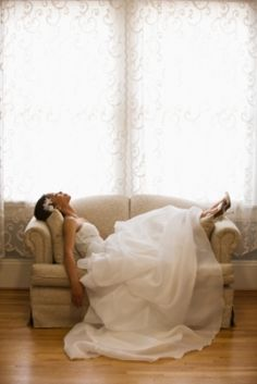 Bride putting her feet up -wedding portrait idea