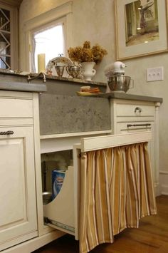 Pull out/drawer for underneath the sink instead of cabinet doors by mary.larrimore.5