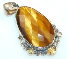 $59.15 Fantastic Shimmering Tigers Eye Sterling Silver Pendant at www.SilverRushStyle.com #pendant #handmade #jewelry #silver #tigers