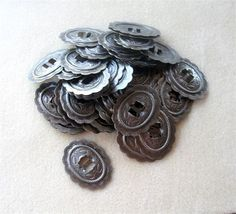 This listing is for (1) gunmetal oval concho. It is a bigger concho and has a nice weight, it does contain nickel but is lead free. It will look great as a pendant or focal in your western wear style designs, as a handbag accessory, belt decor, hat decor, etc.. It measures 1 7/8 x 1 1/2 in size. The slot size is 3/8 inch. The pictures show the front and back of the concho. Must see to appreciate!   1 7/8 x 1 1/2 in size   has nickel  lead free   Please take a look at ...
