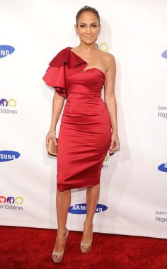 Jennifer Lopez stuns in this classy one-shoulder red dress at the Samsung Hope for Children Gala.