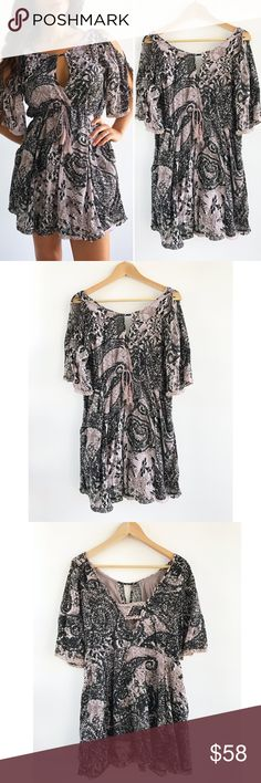 """Free People Boho Shoulder Cutout Dress Free People Boho Shoulder Cutout Dress! This dress give you an effortless boho chic vibe! Excellent condition. Cutout shoulders. Ties around the waist. Pull over. Side pockets. Chest-36"""" waist-29"""" hips-40"""" length-32"""" 100% rayon, lined with 100% cotton. Size small. Free People Dresses"""