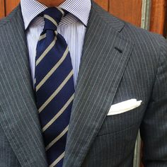 Striped Grey suit with navy blue tie