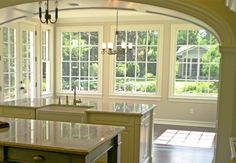 Transitional arch from kitchen to living room