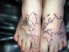 """My newest tattoos -- inspired by the quote """"She had the world at her feet"""""""