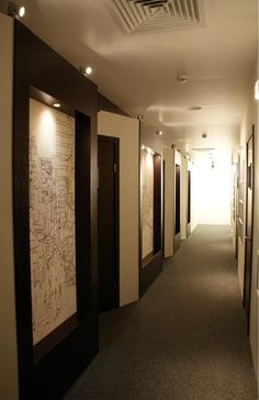 Large scale line drawings on the walls of GSL Law and Consulting Offices, by Abigail Daker