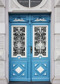 aDOORation | intricate blue and white door in Hanover, Germany | Bayer Built Woodworks